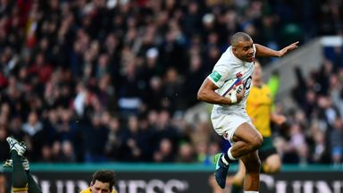 Jonathan Joseph of England (R) scores his sides first try while Bernard Foley of Australia (L) attempts to tackle him.