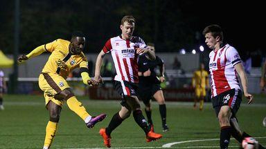 Roarie Deacon of Sutton United scores his team's winning goal