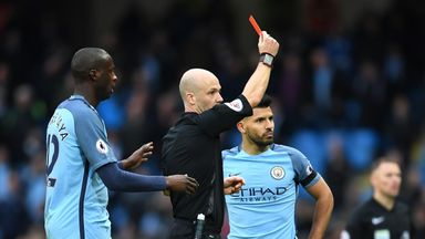 Manchester City's Sergio Aguero is dismissed by Anthony Taylor