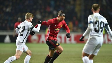 Zorya Luhansk's Serbian midfielder Zeljko Ljubenovic (L) vies for the ball with Manchester United's Swedish forward Zlatan Ibrahimovic (R) during the UEFA