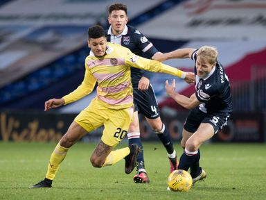 Bjorn Johnsen battles for the ball with Jay McEveley