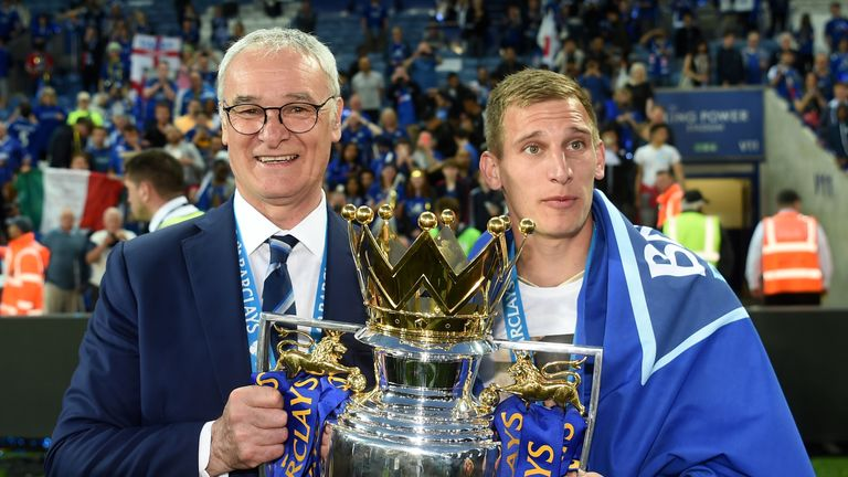 LEICESTER, ENGLAND - MAY 07: Manager Claudio Ranieri (L) and Marc Albrighton (R) of Leicester City the Premier League Trophy as players and staffs celebrat