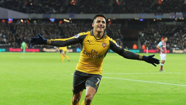 Alexis Sanchez celebrates scoring the 2nd Arsenal goal against West Ham United