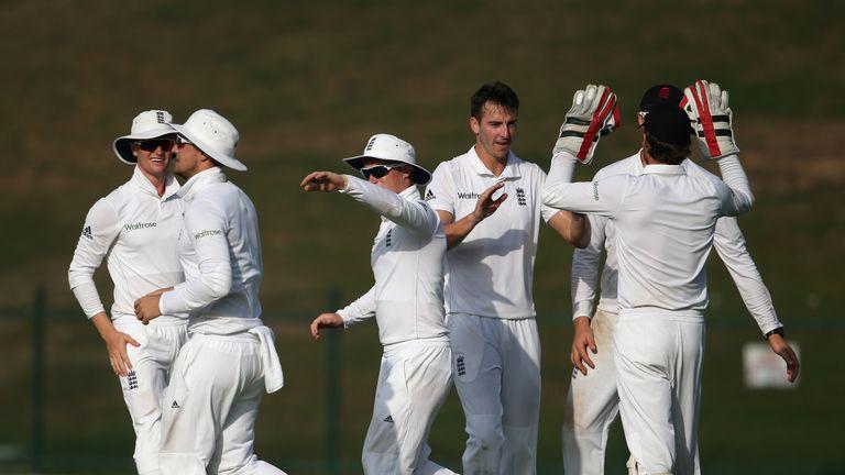 ABU DHABI, UNITED ARAB EMIRATES - DECEMBER 08:  Toby Roland-Jones of England Lions celebrates with teammates after dismissing Karim Janat  of Afghanistan d