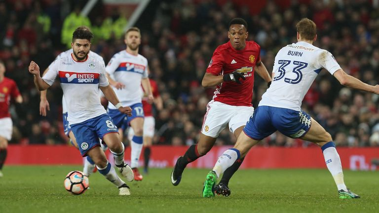 Martial charges forward on the break