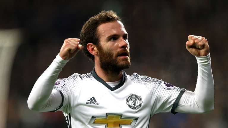Juan Mata celebrates after opening the scoring Man United