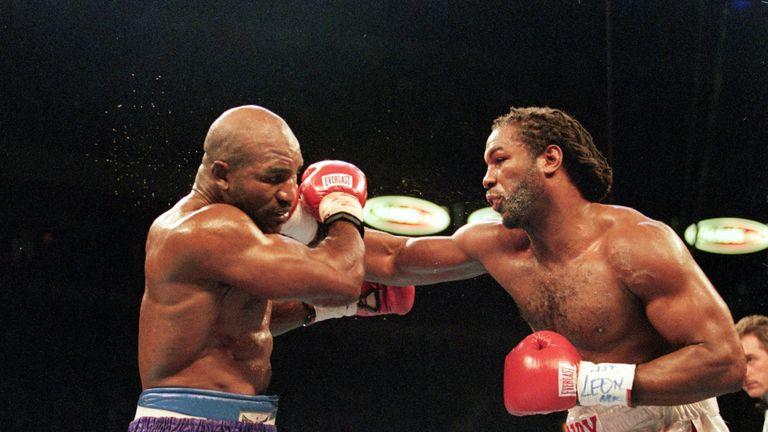 Lennox Lewis fought for three world titles in rematch with Evander Holyfield