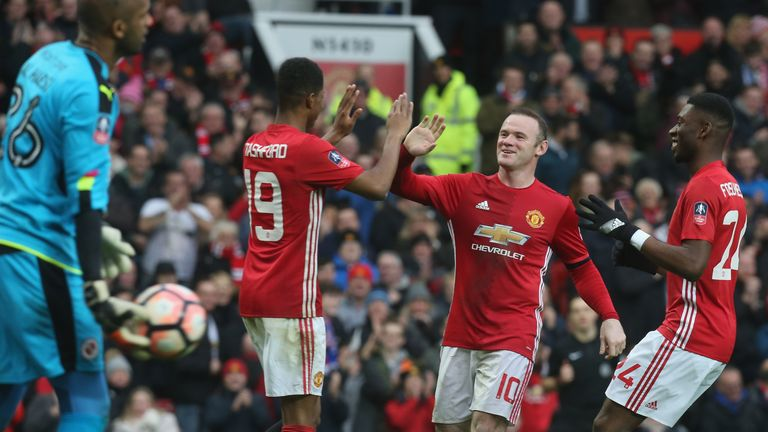 Rashford celebrates his second goal as United eased through