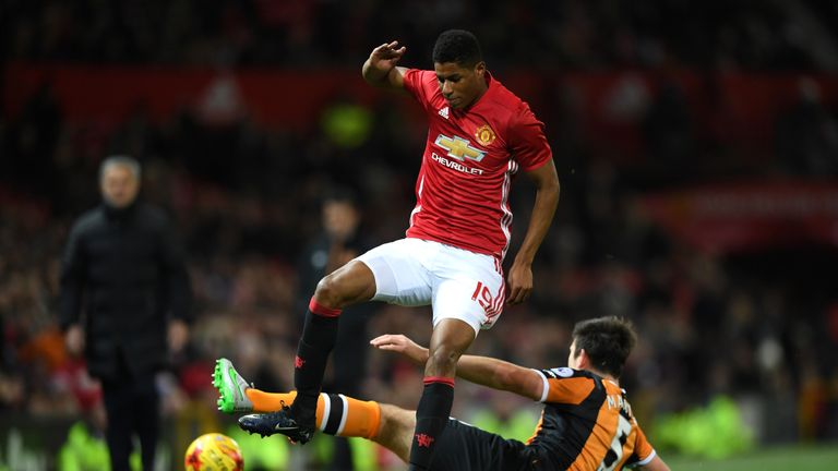 Marcus Rashford is challenged by Harry Maguire