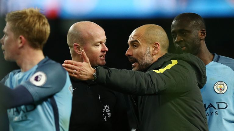 Guardiola remonstrates with referee Lee Mason
