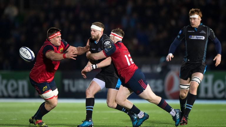 Finn Russell is tackled by Munster's CJ Stander (left) and Rory Scannell
