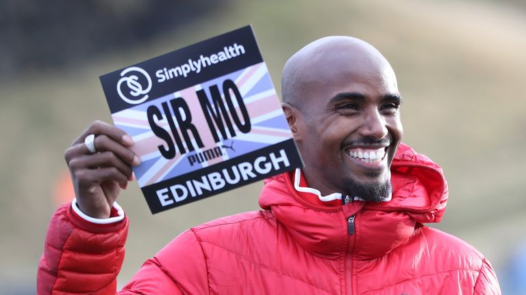 Sir Mo Farah poses for photographs in Holyrood Park prior to Saturday's Great Edinburgh X Country