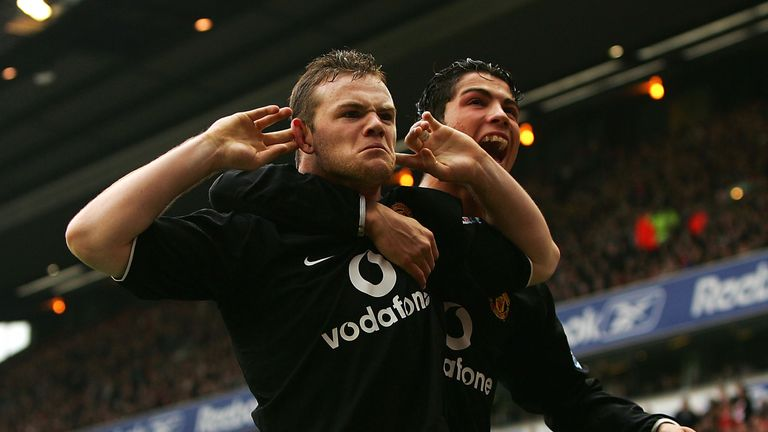 Wayne Rooney and Cristiano Ronaldo celebrate United's opener in front of The Kop