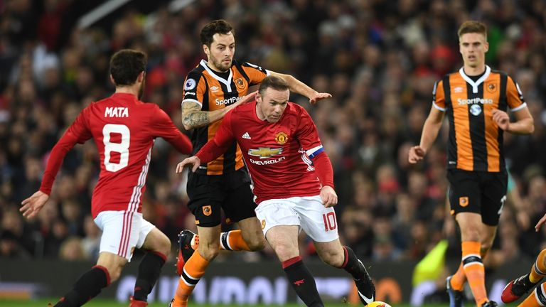 Wayne Rooney is closed down by Ryan Mason during the first half