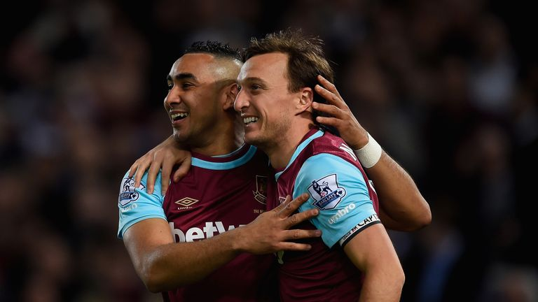 Payet (left) left West Ham to rejoin Marseille in January
