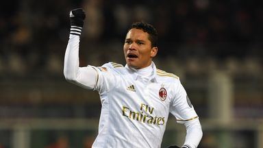 Carlos Bacca of AC Milan celebrates after scoring a penalty against Torino