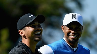 Jason Day (left) says that Tiger Woods (right) is hitting it 'long and straight'