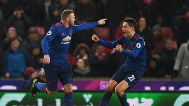Wayne Rooney celebrates his late equaliser against Stoke
