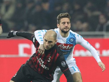 Gabriel Paletta of AC Milan tangles with Napoli's Dries Mertens