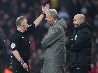 Referee Jonathan Moss orders Arsene Wenger to the stands