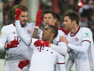 Douglas Costa celebrates with Robert Lewandowski