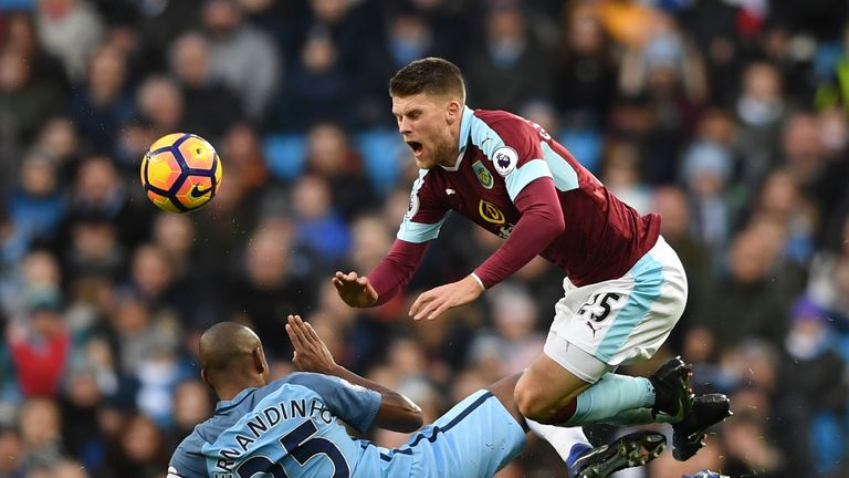 Fernandinho fouls Johann Gudmundsson of Burnley, leading to his red card