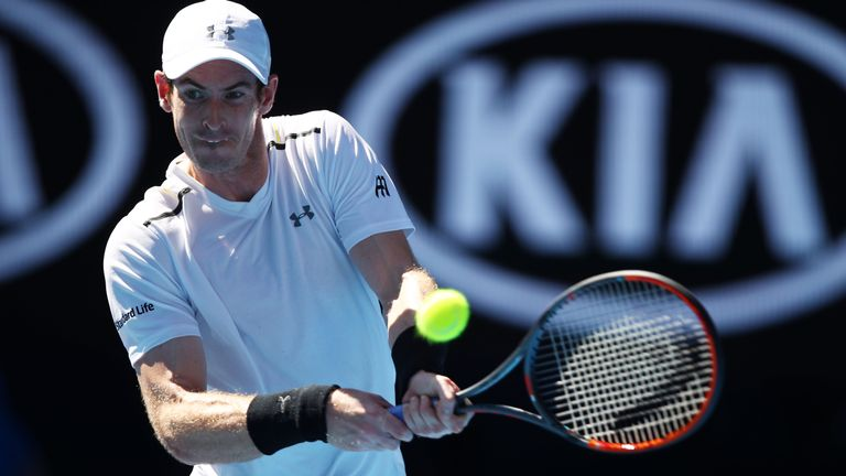 Andy Murray of Great Britain plays a backhand in his first round match against Illya Marchenko of the Ukraine