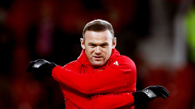 Manchester United's Wayne Rooney warms up before the EFL Cup Semi Final, First Leg match v Hull at Old Trafford, Manchester