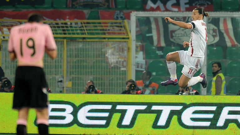 Ibrahimovic (right) celebrates after scoring against Palermo