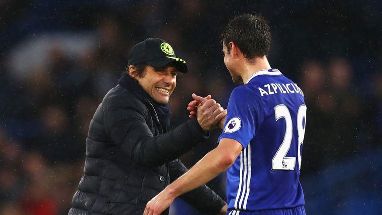 Antonio Conte congratulates Cesar Azpilicueta after Chelsea's win over Swansea