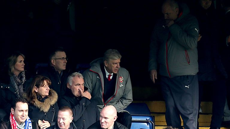 Arsene Wenger sat in the stands at Stamford Bridge while serving his touchline ban