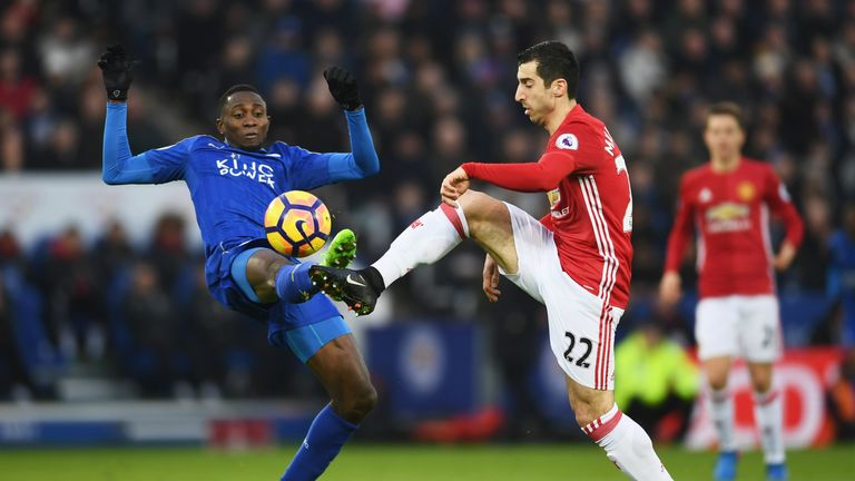 Henrikh Mkhitaryan (right) and Wilfred Ndidi battle for the ball