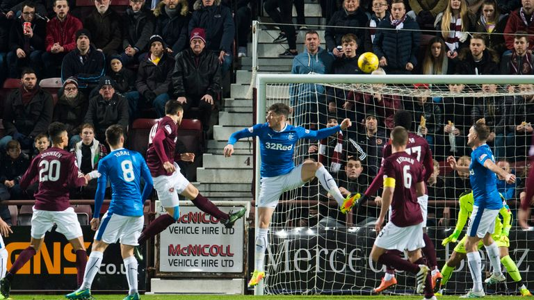 Hearts' Krystian Nowak heads the opener for the home side