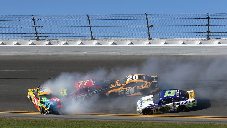 Kyle Busch (L) was leading when his race came to an end in a dramatic crash