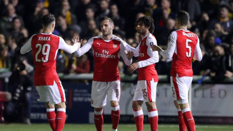 Lucas Perez is congratulated by team-mates after scoring Arsenal's opener against Sutton
