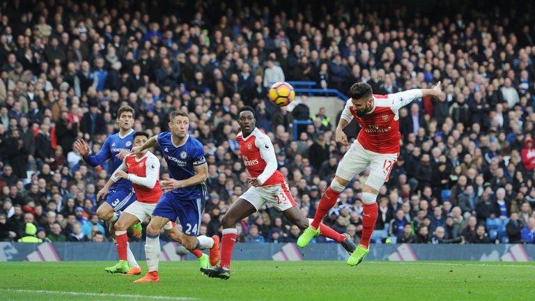 Olivier Giroud (right) scores Arsenal's goal at Stamford Bridge
