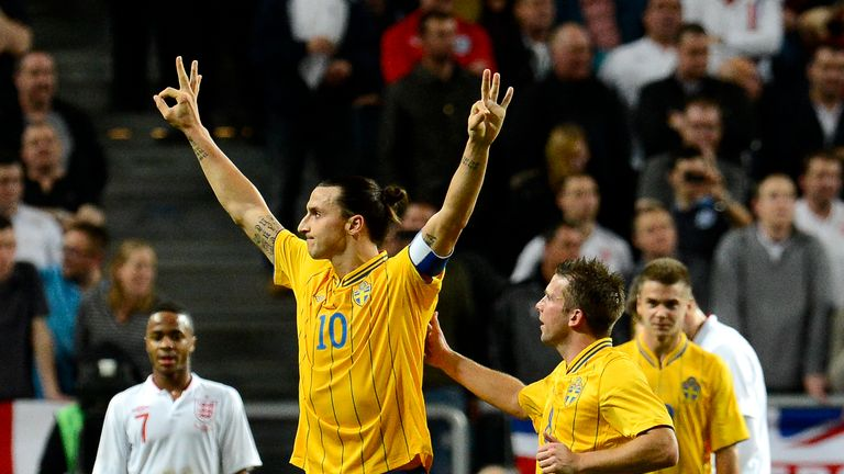 Zlatan Ibrahimovic celebrates after completing a hat-trick against England