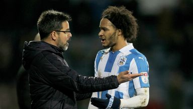 Huddersfield Town manager David Wagner has words with Isaiah Brown