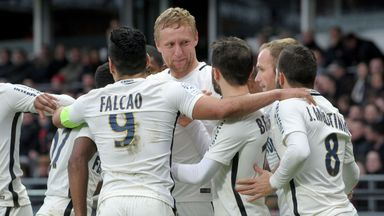 Kamil Glik is mobbed by his team-mates after scoring at Guingamp