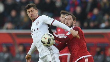 Bayern Munich's Robert Lewandowski (L) challenges for possession