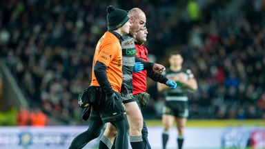 Hull skipper Gareth Ellis is helped from the field after a challenge by Sam Moa