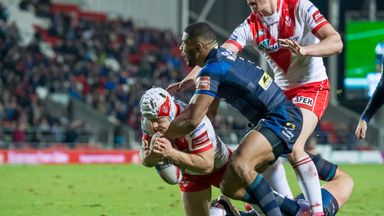 Theo Fages forces his way over the try line as Leeds' Kallum Watkins hangs on
