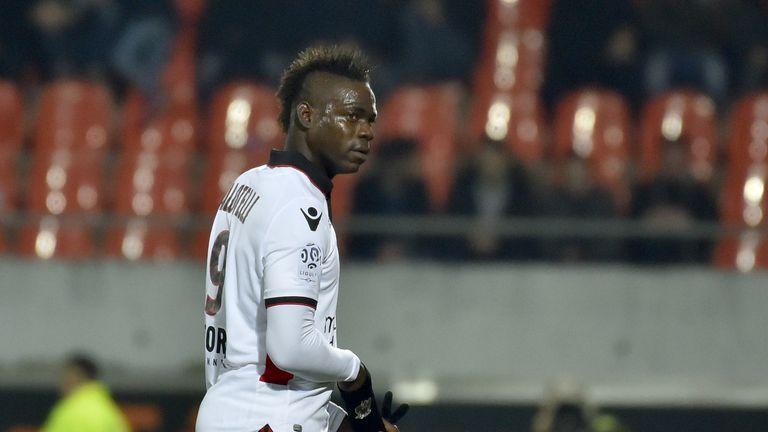 Nice's Italian forward Mario Balotelli (R) leaves the field after receiving a red card during the French L1 football match Lorient vs Nice at the Moustoir