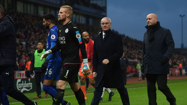 Leicester City's Italian manager Claudio Ranieri (2R) leaves the pitch after remonstrating with the referee at half-time during the English Premier League