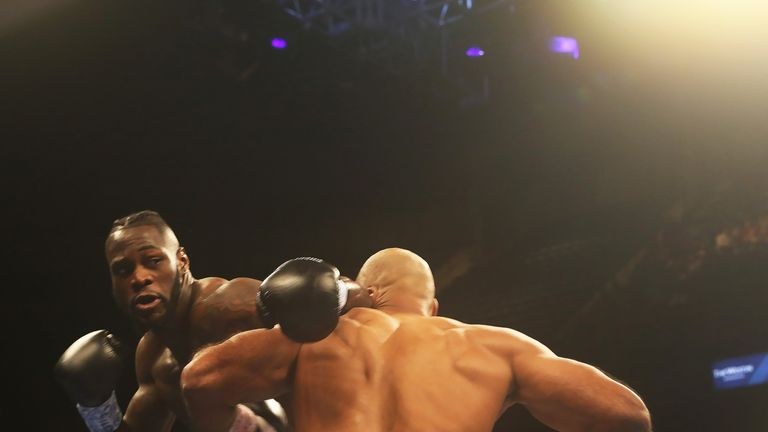 Deontay Wilder and Gerald Washington in action during their WBC World Heavyweight title fight