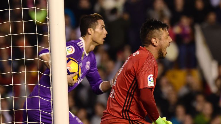 Valencia goalkeeper Diego Alves (R) shouts after Real Madrid's Cristiano Ronaldo scored during the Spanish league football match