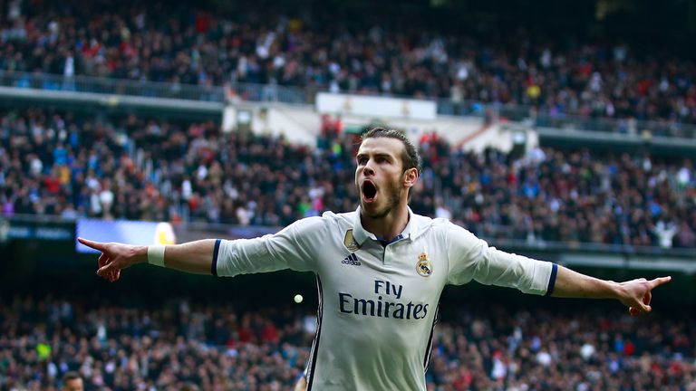 MADRID, SPAIN - FEBRUARY 18:  Gareth Bale of Real Madrid CF celebrates scoring their second goal during the La Liga match between Real Madrid CF and RCD Es