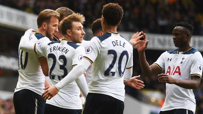 Harry Kane celebrates with team-mates after scoring the opening goal of the game
