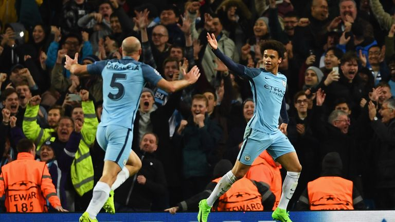 Leroy Sane of Manchester City (R) celebrates as he scores their fifth goal