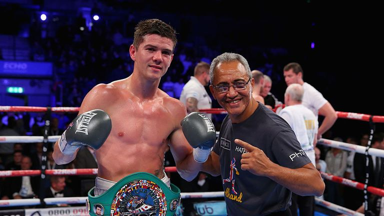 Luke Campbell and trainer Jorge Rubio winning in the WBC Silver Lightweight Championship match during Boxing at Echo Arena.